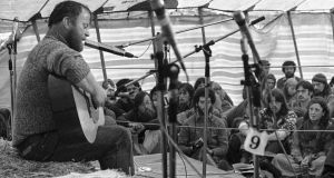 Christy Moore entertains some of the protesters at an Anti-Nuclear protest at Carnsore Point, Co Wexford, in August 1978. Photograph: Eddie Kelly