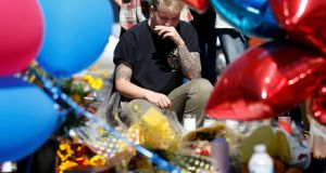 A makeshift memorial in the middle of Las Vegas Boulevard following last Sunday night's  mass shooting in Las Vegas. Photograph: Chris Wattie/Reuters