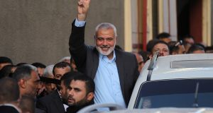 Hamas's overall leader Ismail Haniya waves as he arrives for a meeting with Palestinian officials in Gaza City. Photograph: Said Khatib/AFP/Getty Images