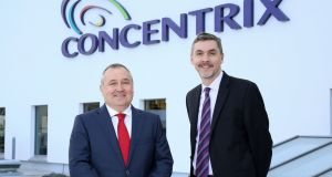 Concentrix senior vice president Philip Cassidy (left)  and president Chris Caldwell at the opening of the global business services company's new  facility at Maysfield, Belfast. Photograph: Darren Kidd/Press Eye