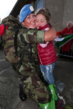 GOLAN RETURN: Cpl Denise Doyle, OF Laois, is greeted by daughter Erin (5) at Casement Aerodrome, when 100 Irish troops from the 55th Infantry Group, United Nations Disengagement Observer Force (UNDOF), returned home after a six-month deployment to the Golan Heights. Photograph: Colin Keegan/Collins