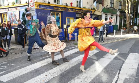 HALLOWEEN BECKONS: Yvette Picque,  Caroline Okwonko and Barra Convery in Galway's Latin Quarter, bringing colourful Macnas parade characters to life. They will take part in this year's Macnas Galway Halloween Parade, Port Na Bpucaí, on Sunday, October 29th. Photograph: Joe O'Shaughnessy