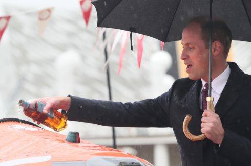 "RAY OF HOPE: Prince William, Duke of Cambridge, pours Bushmills whiskey over a lifeboat in the Titanic Quarter in Belfast as he names it ""Ray of Hope"" for the Lagan search-and-rescue service, which covers the Belfast Harbour Estate, River Lagan and the estuarial waters of Belfast Lough. Photograph: Brian Lawless/WPA Pool/Getty Images"