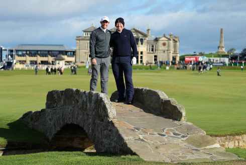 DUNHILL CHAMPIONSHIP: Rory McIlroy of Northern Ireland with his father Gerry McIlroy on the Swilken bridge during day one of the 2017 Alfred Dunhill Championship at the Old Course in St Andrews, Scotland. Photograph: Richard Heathcote/Getty Images