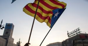 A demonstrator waves a Catalan separatist flag in Madrid, Spain. Photograph: Paul Hanna/Reuters