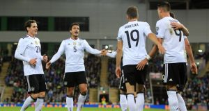 Germany's Sandro Wagner celebrates with teammates after scoring their second goal in the win over Northern Ireland in Belfast. Photo: Paul McErlane/EPA