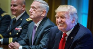 US president Donald Trump  (right) smiles as defence secretary James Mattis (centre) looks on during a meeting with senior military leaders at the White House on Thursday. Photograph: Mandel Ngan/AFP/Getty Images