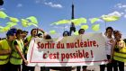 International Campaign to Abolish Nuclear (ICAN) weapons activists in France hold a banner in Paris supporting a nuclear phase-out. ICAN has won the 2017 Nobel Peace Prize. Photograph: AFP