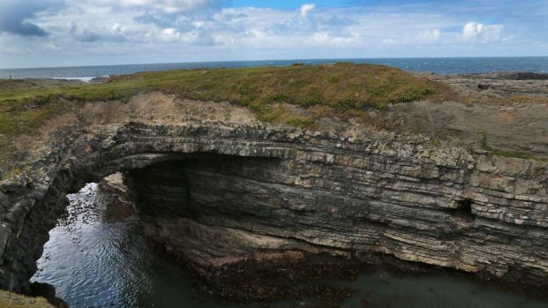 The Bridges of Ross: a single surviving sea arch looking out on the Atlantic that carved it