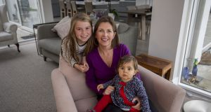 Elaine Russell with her daughters Grace (11 months) and Laura (8)  at their home in Foxrock. Elaine has brought the UK organisation 'Women Returners' to Ireland and is pioneering the concept of 'returnships' with companies here. Photograph: Brenda Fitzsimons