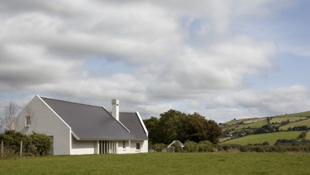 Traditional forms, pitched roofs, slate, plaster and long dry granite stone walls help ground both existing house and new extension into the landscape, as is the tradition