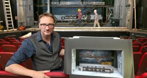 Set designer Francis O'Connor with his model box in Galway's Town Hall Theatre as the set is constructed for Druid's production of King of the Castle. Photograph: Joe O'Shaughnessy
