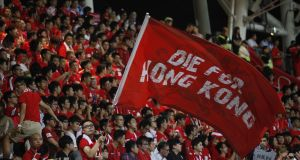 A Hong Kong fan waves a flag that reads 'Die for Hong Kong' during a world cup qualifier at Mong Kok stadium in Hong Kong in 2015. File photograph: Isaac Lawrence/AFP/Getty Images