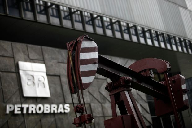A replica of an old oil pump stands outside the headquarters of Petroleo Brasileiro SA (Petrobras) in Rio. Brazil's state-controlled oil giant is central to the corruption scandal. Photograph: Dado Galdieri/Bloomberg