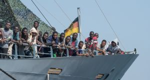 Migrants on the German military ship Rhein. Photograph: Alfonso Di Vincenzo/Kontrolab/LightRocket via Getty Images