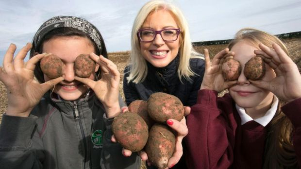 National Potato Day: Sarah Guinan and Áine Kelledy from St Kevin's National School in Philipstown, Co Louth, at John Carroll's potato farm, in Paughanstown, with the dietician Aoife Hearne. Photograph: Colm Mahady/Fennell