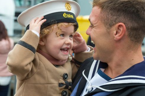 DADDY'S HOME: Seane Keane from Greenmount, Cork, with his daughter Laci (3) as the LÉ 'William Butler Yeats' returns from the Meditteranean to Haulbowline. Photograph: Michael Mac Sweeney/Provision