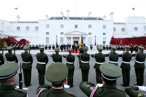 AT ATTENTION: President Michael D Higgins inspecting the Guard of Honour before departing Áras an Uachtaráin for a State visit to Australia. Photograph: Maxwell Photography