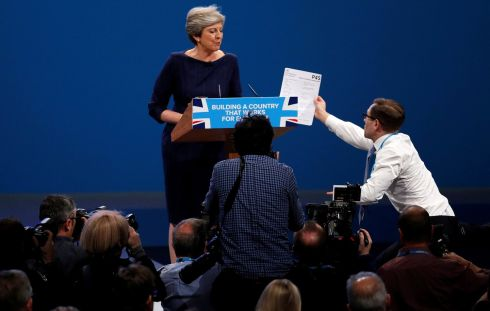 MAY NIGHTMARE: Comedian Simon Brodkin, aka Lee Nelson, hands a P45 form to Britain's prime minister Theresa May as she addresses the Conservative Party conference in Manchester. Photograph: Phil Noble/Reuters