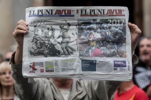 MORNING AFTER: A man holds up a newspaper showing images of police violence during a government and union protest outside the Palau Generalitat building over the crackdown on the referendum in Barcelona. Photograph: Chris McGrath/Getty Images