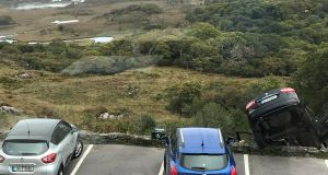 A car which had been driven by tourists was left dangling over the lakes of Killarney at lunchtime on Friday. Photograph: Raymond O'Shea