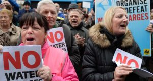 Anti-water charge protesters in 2012: the Water Services Bill seeks to draw a line under the Irish Water debacle. Photograph:  Dara Mac Donaill