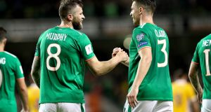 Daryl Murphy celebrates scoring  with Ciaran Clarke. Photograph: Ryan Byrne/Inpho