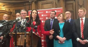 Jacinda Ardern (centre), New Zealand's new opposition Labour leader, speaks to the press alongside members of her party in August. Photograph: Charlotte Greenfield/Reuters/File Photo