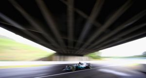 Lewis Hamilton in action during qualifying for the Grand Prix of Japan at Suzuka. Photograph: Clive Mason/Getty Images