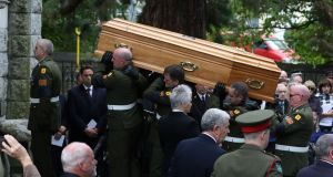 Military Pallbearers carry the coffin into the church at funeral of former taoiseach Liam Cosgrave at Church of the Annunciation, Rathfarnham. Photograph Nick Bradshaw