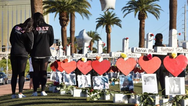 Members of the University of Las Vegas pom squad visit 58 white crosses for the victims of the attack. Photograph: Robyn Beck/AFP/Getty Images