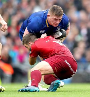 Leinster's Tadhg Furlong tackled by Ian Keatley of Munster. Photograph: Billy Stickland/Inpho