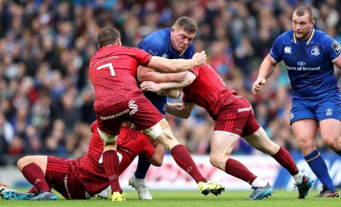 Leinster's Tadhg Furlong tackled by Ian Keatley, Tommy O'Donnell and Keith Earls of Munster. Photograph: Billy Stickland/Inpho