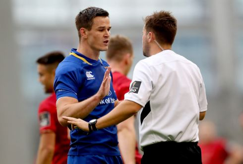 Leinster's Johnny Sexton speaks to referee Ben Whitehouse before Munster's Keith Earls first-half try was disallowed. Photograph: James Crombie/Inpho
