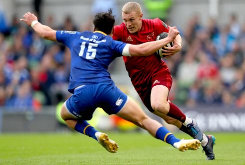 Leinster's Joey Carbery lines up to tackle Keith Earls of Munster. Photograph: James Crombie/Inpho