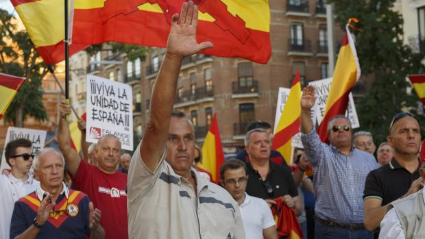 Demonstrators do the fascist salute during a protest against the independence of Catalonia under the slogan 'For the unity of Spain' called by far right wing party Falange Espaola de las Jons at Salvador Dali Square on October 7, 2017 in Madrid, Spain. Photograph: Pablo Blazquez Dominguez/Getty Images