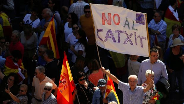 A man holds up a banner reading 'No Catxit' in reference to a Catalan Brexit, during a pro-union demonstration organised by the Catalan Civil Society organisation in Barcelona, Spain on Sunday. Photograph: Rafael Marchante/Reuters