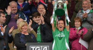 Fermanagh captain Aine McGovern of  holds aloft the trophy after the the TG4 Ladies Football All-Ireland Junior Championship final replay against  Derry at  St Tiernach's Park in Clones. Photograph:  Oliver McVeigh/Sportsfile