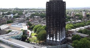 A view of the damaged in the fire Grenfell Tower, a 24-storey apartment block in North Kensington, London. Photograph: Facundo Arrizabalaga/EPA