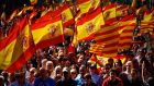"Protesters hold Spanish flags during a demonstration in Barcelona on Sunday called by ""Societat Civil Catalana"" (Catalan Civil Society) to support the unity of Spain. Photograph:  Jorge Guerrero/AFP/Getty Images"