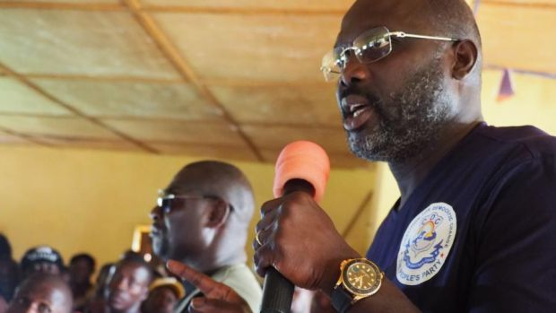 Liberian election: George Weah talks in the bush village of Todee. Photograph: Lorraine Mallinder