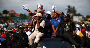 Liberian election: George Weah and Jewel Haward-Taylor wave to supporters. Photograph: Nic Bothma/EPA