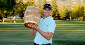 Brendan Steele poses with the trophy after winning The Safeway Open at the North Course of the Silverado Resort and Spa in Napa, California. Photo: Robert Laberge/Getty Images