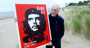 Artist Jim Fitzpatrick with a promotional image of a stamp featuring his world famous image of Che Guevara.