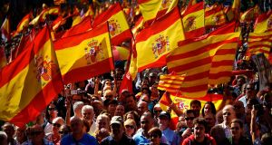 "Protesters hold Spanish flags during a demonstration called by ""Societat Civil Catalana"" (Catalan Civil Society) to support the unity of Spain on Sunday in Barcelona. Photograph: Jorge Guerrro/AFP/Getty Images"