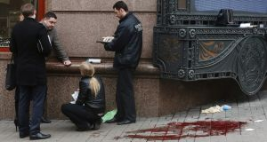 Police collect evidence at the site of the murder of Denis Voronenkov, last March, in Kiev. Photograph: Ivan Kovalenko/Kommersant via Getty Images