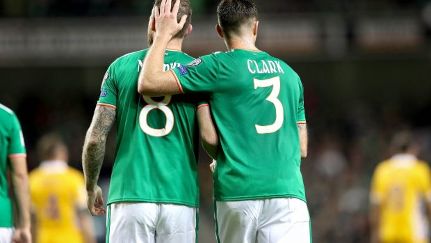 Ciaran Clark celebrates with Daryl Murphy after his second goal against Moldova. Photo: Ryan Byrne/Inpho