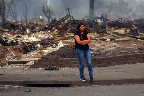Ofelia Vargas, whose own home burned, among destroyed homes in the Coffey Park subdivision in Santa Rosa, California. Photograph: Jim Wilson/The New York Times