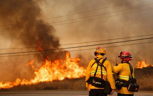 Firefighters work to contain the blaze in Anaheim Hills, California. Photograph: Eugene Garcia/EPA