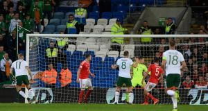Ireland's James McClean watches his shot go fly past Wayne Hennessey in the 1-0 World Cup qualifying win over Wales in Cardiff. Photo: Stu Forster/Getty Images